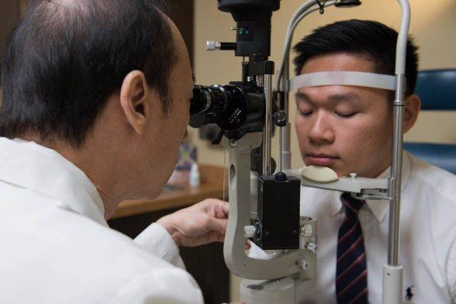 Young man having his eyes examined - optometrist - eye care - Fort Worth, TX